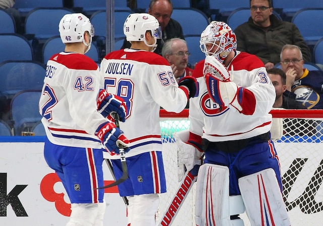 BUFFALO, NY - MARCH 23: Antti Niemi #37 of the Montreal Canadiens is congratulated by Noah Juulsen #58 and Byron Froese #42 after beating the Buffalo Sabres at KeyBank Center on March 23, 2018 in Buffalo, New York. Antti Niemi registered a shutout.   Kevin Hoffman/Getty Images/AFP == FOR NEWSPAPERS, INTERNET, TELCOS & TELEVISION USE ONLY ==