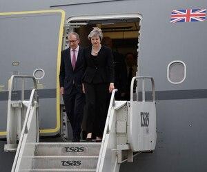 La première ministre du Royaume-Uni, Theresa May, est arrivée peu après 18h.
