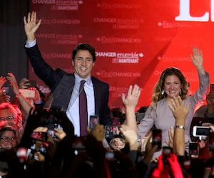 Liberal Party leader Justin Trudeau waves while accompanied by his wife Sophie Gregoire as he arrives to give his victory speech after Canada's federal election in Montreal