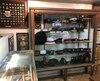 La salle de montre de William Scully Limité contient des chapeaux, des médailles, des écussons, des épées honorifiques, qui retracent ses 151 ans d'existence.