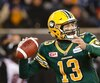 Edmonton Eskimos quarterback Mike Reilly looks to pass against the Ottawa Redblacks during the CFL's 103rd Grey Cup championship football game in Winnipeg