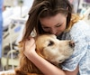 Therapy Dog Visiting Young Female Patient In Hospital
