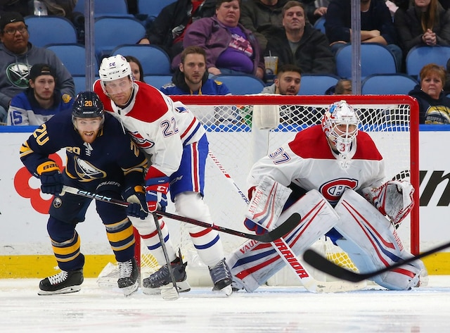 BUFFALO, NY - MARCH 23: Antti Niemi #37 of the Montreal Canadiens tends net as Scott Wilson #20 of the Buffalo Sabres and Karl Alzner #22 fight for position during the third period at KeyBank Center on March 23, 2018 in Buffalo, New York.   Kevin Hoffman/Getty Images/AFP == FOR NEWSPAPERS, INTERNET, TELCOS & TELEVISION USE ONLY ==