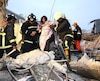Rescue personnel help a victim at a damaged building after an earthquake in Tainan