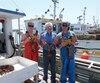 Francis Déraspe, 23 ans, son grand-père, John-Fred, 83 ans, ainsi que son père, Denis, 50 ans, sont très satisfaits de la pêche de cette saison.