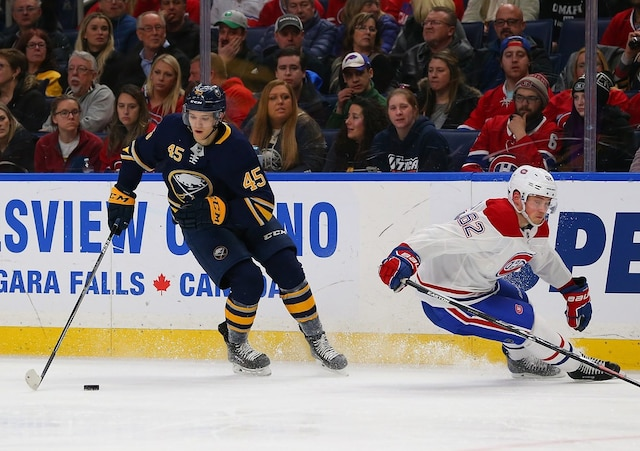 BUFFALO, NY - MARCH 23: Brendan Guhle #45 of the Buffalo Sabres skates up ice with the puck as Artturi Lehkonen #62 of the Montreal Canadiens defends during the second period at KeyBank Center on March 23, 2018 in Buffalo, New York.   Kevin Hoffman/Getty Images/AFP == FOR NEWSPAPERS, INTERNET, TELCOS & TELEVISION USE ONLY ==