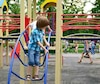 children playing on playground in summer outdoor park