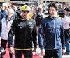 Lance Stroll marchait vers les puits en présence de Carlos Sainz jr avant le départ de la course à Austin, dimanche.