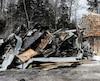 En milieu d'après-midi hier, les restes de la maison de Joé Juneau étaient encore bien fumants.