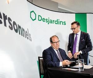 Guy Cormier, PDG de Desjardins et Denis Berthiaume, premier V.-P. exécutif et chef de l'exploitation en point de presse le 20 juin.