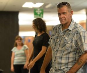 Richard Trottier a nié avoir tenté de tuer son ex-conjointe en la jetant d'un balcon, mais le juge Yvan Poulin ne l'a pas cru.