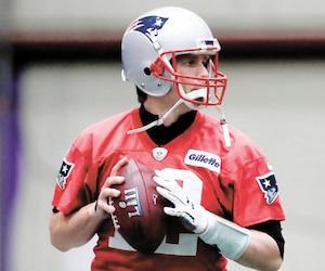 Tom Brady, quart-arrière des Patriots, à l'entraînement vendredi.