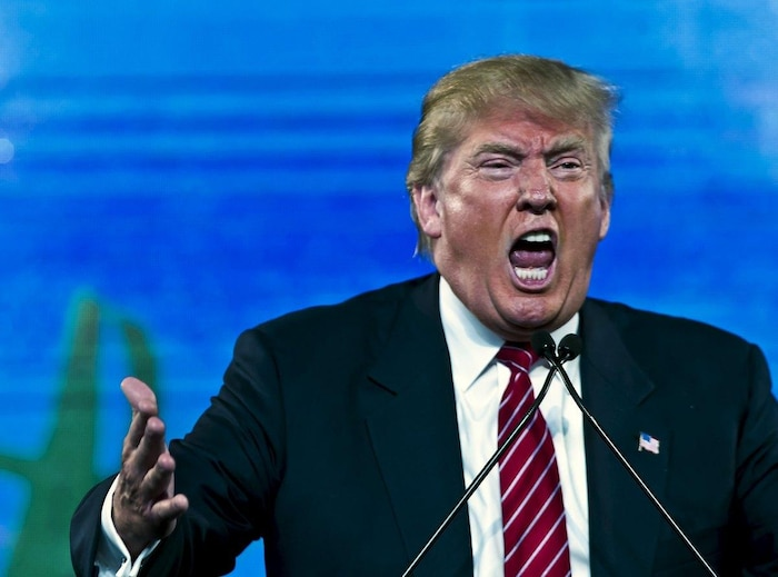 Republican Presidential candidate Trump reacts as he speaks at the 2015 FreedomFest in Las Vegas