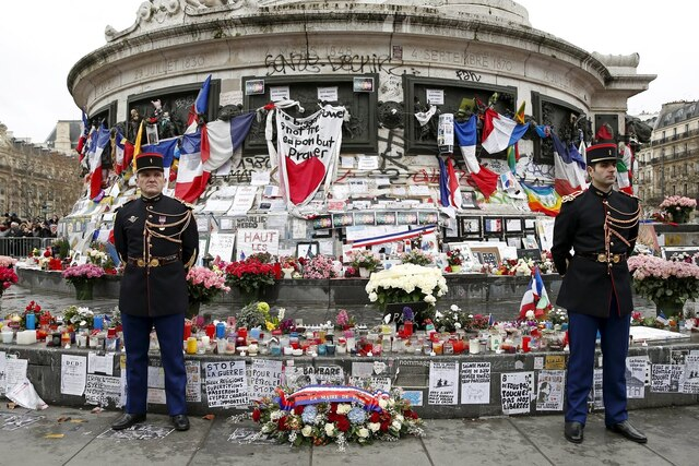 French Republican guards stand during a ceremony at Place de la Republique square to pay tribute to the victims of last year's shooting at the French satirical newspaper Charlie Hebdo, in Paris, France, January 10, 2016. France this week commemorates the victims of last year's Islamist militant attacks on satirical weekly Charlie Hebdo and a Jewish supermarket with eulogies, memorial plaques and another cartoon lampooning religion.  REUTERS/Yohan Valat/Pool      TPX IMAGES OF THE DAY