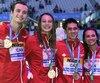 Kylie Masse, Richard Funk, Penny Oleksiak et Yuri Kisil de l'équipe canadienne.