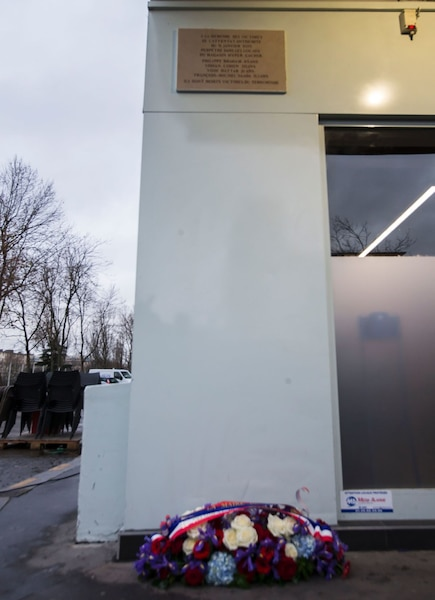 A picture taken on January 5, 2016 near Paris shows a commemorative plaque outside the Hyper Cacher, a kosher supermarket, during a ceremony to pay tribute to the victims of the terrorist attack on the supermarket on January 9, 2015. French President Francois Hollande today kicked off a week of commemorations marking the jihadist rampage in Paris that began with an assault on satirical weekly Charlie Hebdo and lasted three days, claiming 17 lives. The president and mayor unveiled a plaque at the Hyper Cacher, in an eastern suburb where four Jews -- three shoppers and an employee -- were killed during a horrifying hostage drama. / AFP / POOL / IAN LANGSDON