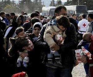 Des réfugiés syriens à la frontière de la Grèce.