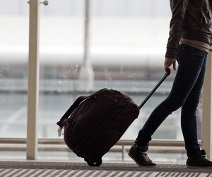 Woman carries your luggage at the airport terminal
