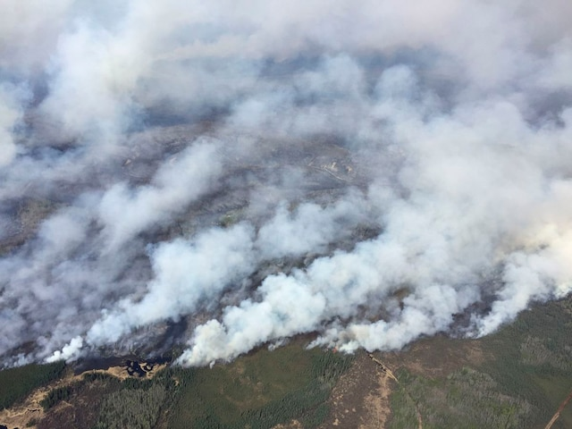 An aerial view from the helicopter of Alberta Premier Rachel Notley shows smoke rising from raging wildfires which caused the mandatory evacuation of Fort McMurray, Alberta, Canada May 4, 2016.    Cheryl Oates/Government of Alberta/Handout via REUTERS   TPX IMAGES OF THE DAY   ATTENTION EDITORS - THIS IMAGE WAS PROVIDED BY A THIRD PARTY. EDITORIAL USE ONLY