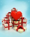 christmas gift boxes with love surprise at winter snowfall