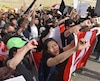 Des militants prodémocratie à Hong Kong ont manifesté, entre autres, à Vancouver samedi.