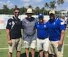 Gabriel Cousineau, Mark Richt (entraîneur-chef des Hurricanes de l'Université de Miami), Danny Maciocia (entraîneur-chef des Carabins de l'Université de Montréal) et Byron Archambault posent pendant un mini-camp des Hurricanes, à Miami, en avril 2018.