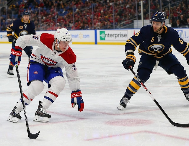BUFFALO, NY - MARCH 23: Daniel Carr #43 of the Montreal Canadiens tries to skate around Marco Scandella #6 of the Buffalo Sabres with the puck during the first period at KeyBank Center on March 23, 2018 in Buffalo, New York.   Kevin Hoffman/Getty Images/AFP == FOR NEWSPAPERS, INTERNET, TELCOS & TELEVISION USE ONLY ==