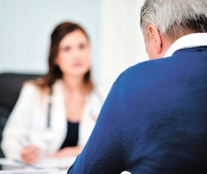 Patient talking to a doctor during a visit