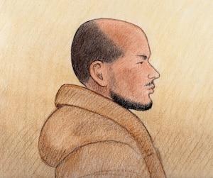 Suliman Mohamed (ci-haut) a brièvement comparu à Ottawa en compagnie des jumeaux Ashton et Carlos Larmond dans une affaire de terrorisme.