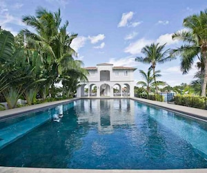 Handout photo of pool house and pool of waterfront mansion previously owned by Al Capone on Palm Island in Miami Beach