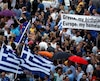 Pro-Euro protestors hold Greek flags as they gather on Constitution square in front of the parliament building in Athens