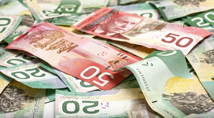 Backgroun made of layed down canadian money