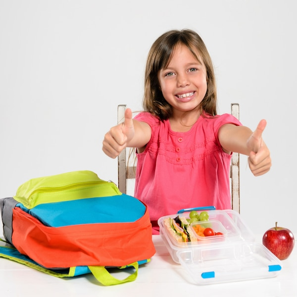 Adorable school girl with healthy lunch