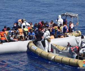 Migrants are rescued by the Italian Navy in the Mediterranean Sea in this handout courtesy of the Italian Navy