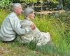 Elderly couple at table in autumn forest