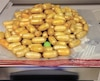 L'homme que nous avons interrogé a avalé une centaine de capsules remplies d'héroïne, semblables à celles-ci, pour les ramener au Canada.