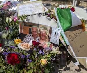 A photograph of a tourist couple, who was killed during Friday's attack, is pictured at a makeshift memorial at the beachside of the Imperial Marhaba resort in Sousse