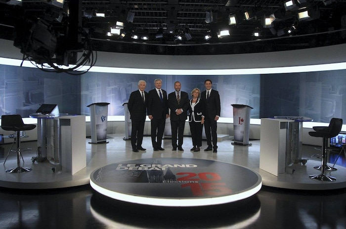 Bloc Quebecois leader Duceppe, Conservative leader and PM Harper, NDP leader Mulcair, Green Party leader May, and Liberal leader Trudeau pose before the start of the French language leaders' debate in Montreal