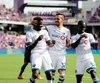 Orji Okwonkwo, Maximiliano Urruti, Michael Azira et Samuel Piette célébrant un but lors du dernier match de l'Impact, à Orlando.