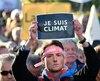 Un manifestant exprime son inquiétude en marge de la COP23 à Bonn, en Allemagne. / AFP PHOTO / SASCHA SCHUERMANN
