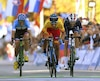 (L-R) 3rd placed Michael Woods of Canada, winner Alejandro Valverde of Spain and 2nd placed Romain Bardet of France cross the finish line of the Men's Elite road race of the 2018 UCI Road World Championships in Innsbruck, Austria on September 30, 2018. (Photo by Christof STACHE / AFP)