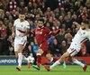 Un supporteur de Liverpool était entre la vie et la mort mercredi, souffrant de sérieuses blessures à la tête.