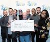 Le groupe de collègues du secteur de la finance à Montréal a remporté 60M$ à la loterie la semaine dernière. De gauche à droite Haidar Abi Haidar, Robert Macri, Julie Béland, Enzo Scattone, Peter Jewett, Randolph Dandan, Nathaniel Thomas, Darius Hozhabr Zandi et Diane Dorele Fossouo Djuidje.