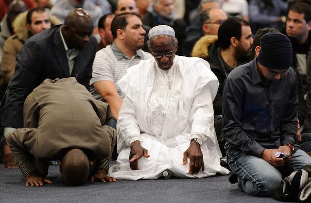 Cérémonie funéraire au Centre des congrès de Québec en l'honneur de trois des six victimes de la tuerie de la mosquée.