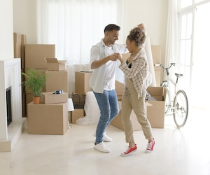Happy young couple celebrating moving home