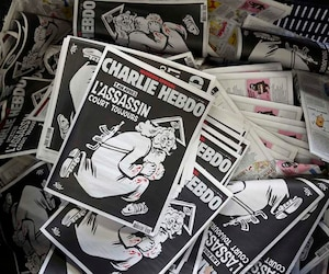 Copies of the latest edition of French weekly newspaper Charlie Hebdo are seen at a printing house near Paris