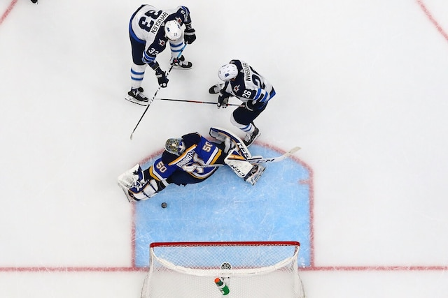 ST. LOUIS, MO - APRIL 20: Dustin Byfuglien #33 of the Winnipeg Jets scores a goal against Jordan Binnington #50 of the St. Louis Blues in Game Six of the Western Conference First Round during the 2019 NHL Stanley Cup Playoffs at the Enterprise Center on April 20, 2019 in St. Louis, Missouri.   Dilip Vishwanat/Getty Images/AFP == FOR NEWSPAPERS, INTERNET, TELCOS & TELEVISION USE ONLY ==