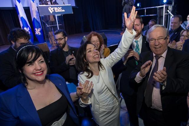 La nouvelle chef du Bloc Québécois, Martine Ouellet, s'adresse aux militants du Bloc Québécois pour la première fois depuis son élection lors un rassemblement du Bloc Québécois au Théâtre Plaza à Montréal, samedi le 18 mars, 2017. Sur cette photo: Marilène Gill, gauche, député pour la circonscription de Manicouagan, et Louis Plamondon, droite, député pour la circonscription de Bécancour—Nicolet—Saurel.  DARIO AYALA/AGENCE QMI