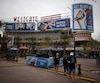 People walk through the Westgate shopping mall near the University of Phoenix Stadium, where the Super Bowl XLIX will be held on Sunday, in Glendale