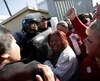 Family members of inmates react as police block the entrance to the Topo Chico prison in Monterrey
